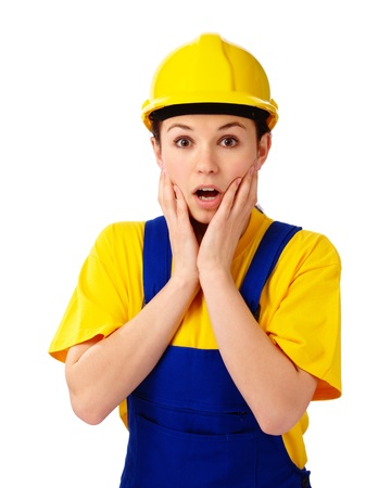 Young attractive construction girl holding her face in astonishment, isolated over white Stock Photo - 9030529