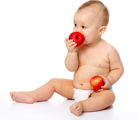 Portrait of a cute little child with two red apples, isolated over white Stock Photo - 9097214