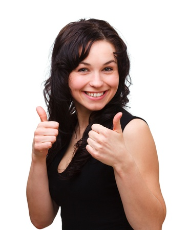 thumbs up symbol: Young woman dressed in black is showing thumb up gesture, isolated over white