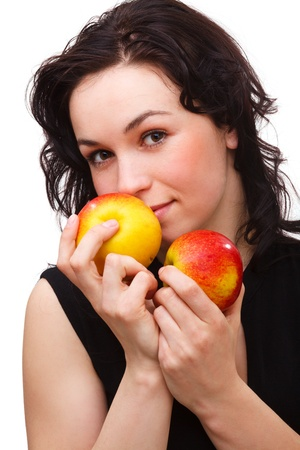 Portrait of a young attractive woman with two red apple, isolated over white photo