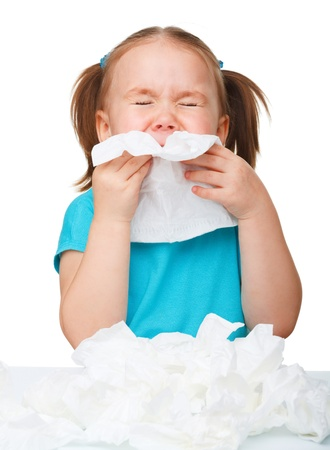 öksürük: Little girl blows her nose, isolated over white