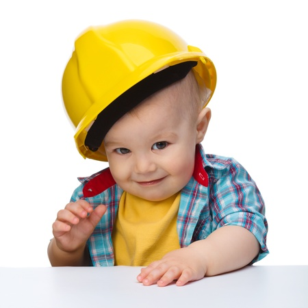 oversized: Portrait of a cute little boy wearing oversized hard hat, isolated over white Stock Photo