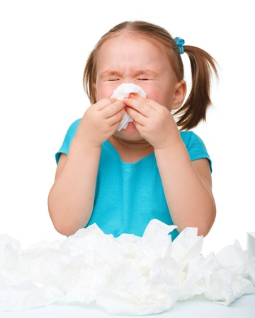 cough medicine: Little girl blows her nose, isolated over white