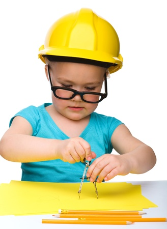 vertical divider: Cute little girl play with divider wearing hard hat, isolated over white