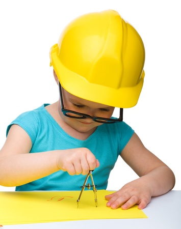 Cute little girl play with divider wearing hard hat, isolated over white photo