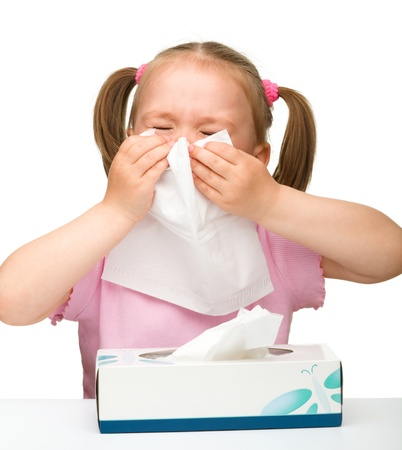 cough: Little girl blows her nose, isolated over white