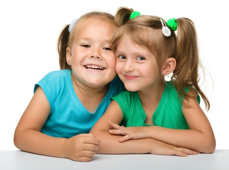 kid friendly: Two little girls - best friends, isolated over white Stock Photo