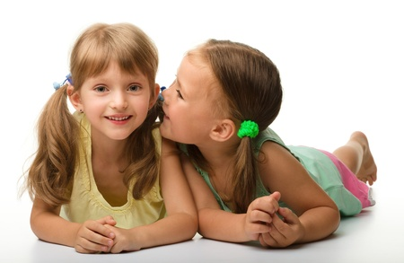 blab: Two little girls are chatting, isolated over white