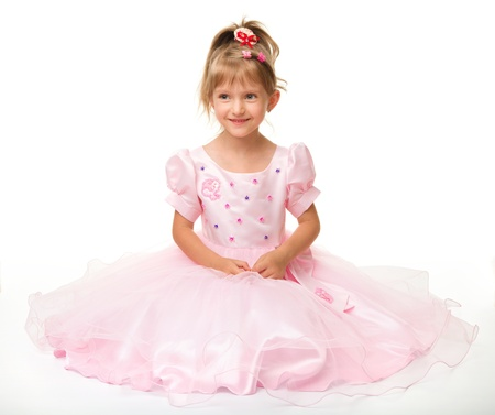 kids dress: Cute little girl in pink dress, isolated over white