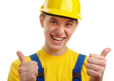Young construction worker showing good hand sign, isolated over white photo