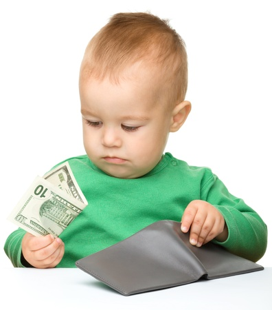salary: Cute little boy is counting money, isolated over white Stock Photo