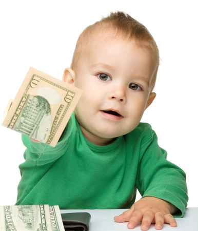 Cute little boy is counting money, isolated over white Imagens