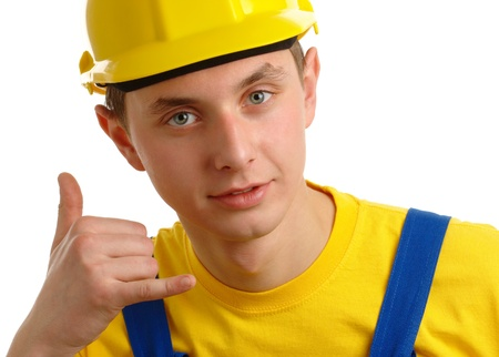 Young construction worker showing call me hand sign, isolated over white photo