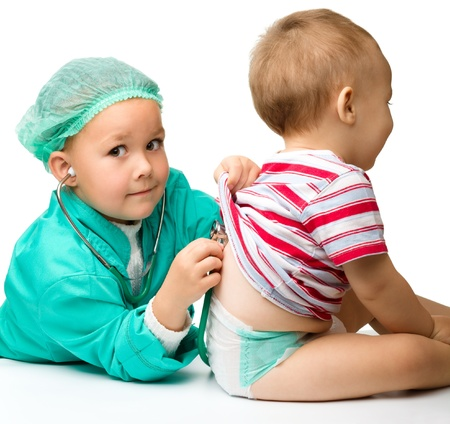 male nurse: Cute children are playing doctor with stethoscope, isolated over white Stock Photo