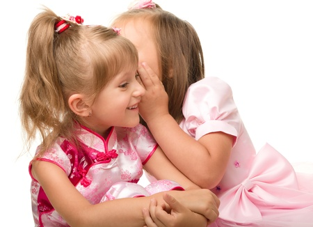 Two little girls are chatting, isolated over white photo