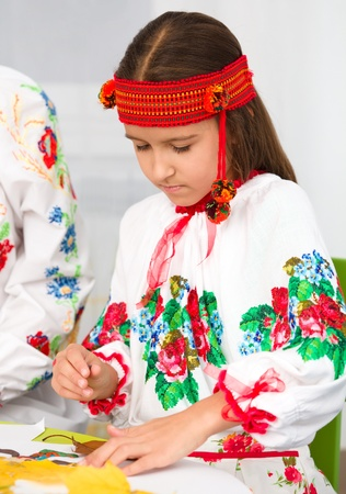 playing folk: Portrait of a girl in Ukrainian national cloth