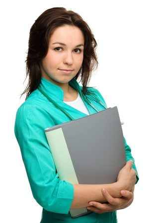 Portrait of a happy young attractive woman wearing doctor uniform, isolated over white photo