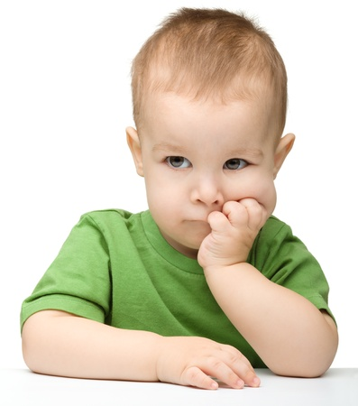 bored face: Portrait of a cute and pensive little boy support his head with hands, isolated over white