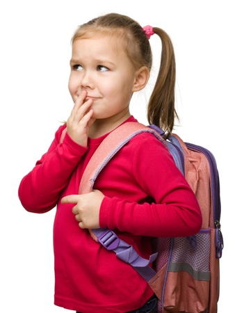 Portrait of a cute little schoolgirl with backpack thinking about something, isolated over white Stock Photo - 12850683
