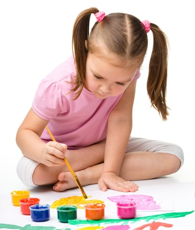preschoolers: Cute cheerful child play with paints, isolated over white