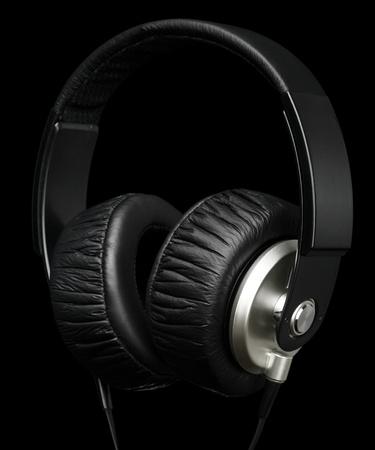 ear phones: Big headphones, isolated over black Stock Photo