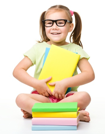 Cute little girl with books, isolated over white Stock Photo - 13363490