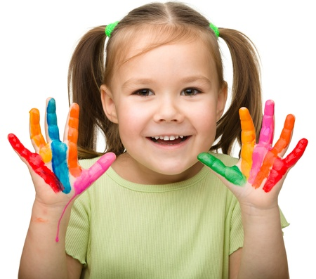 preschoolers: Portrait of a cute cheerful girl with painted hands, isolated over white