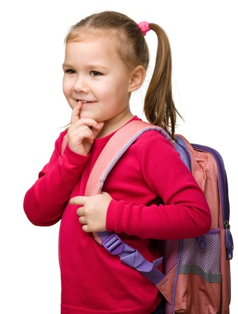Portrait of a cute little schoolgirl with backpack thinking about something, isolated over white Stock Photo - 13514206
