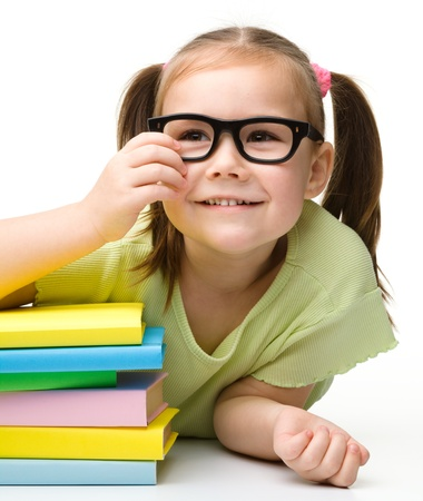 Cute little girl with books, isolated over white Stock Photo - 13514182