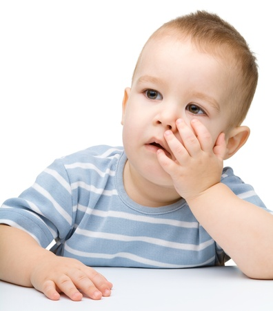 bored face: Portrait of a cute and pensive little boy, isolated over white Stock Photo