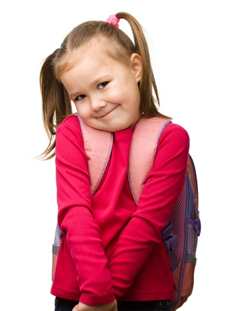 shyness: Portrait of a cute little schoolgirl with backpack, isolated over white