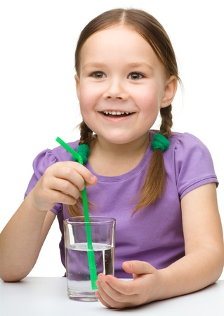 Cute little girl with a glass of water, isolated over white photo