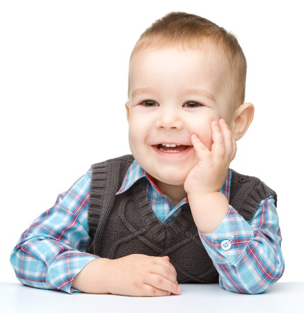 Portrait of a cute and happy little boy, isolated over white photo