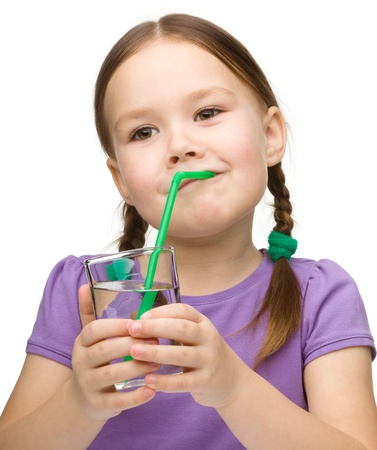 Cute little girl with a glass of pure water, isolated over white photo