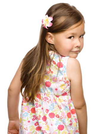 looking over shoulder: Little girl is looking back over her shoulder, isolated on white