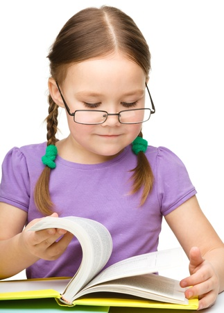 Cute little girl reading book wearing glasses, isolated over white photo