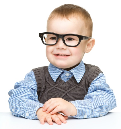 little boy: Portrait of a cute little boy wearing glasses, isolated over white