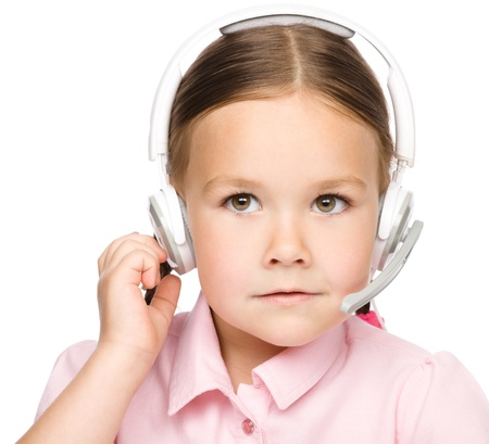 Cute young girl is working as an operator at helpline talking with customer using headset, isolated over white photo
