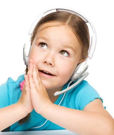 child praying: Cute young girl is working as an operator at helpline holding hands up to face praying for help, isolated over white Stock Photo