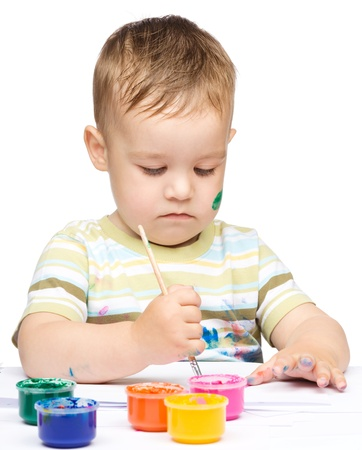 Portrait of a cute little boy playing with paints, isolated over white Stock Photo - 15335167