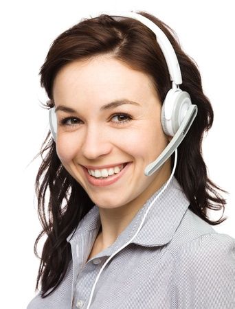 Closeup portrait of lovely young woman talking to customers as a consultant using headset, isolated over white photo