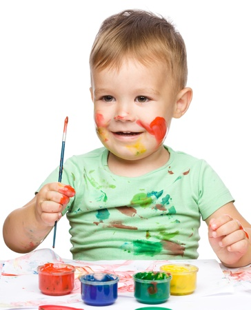 Portrait of a cute little boy playing with paints, isolated over white Stock Photo - 15335196