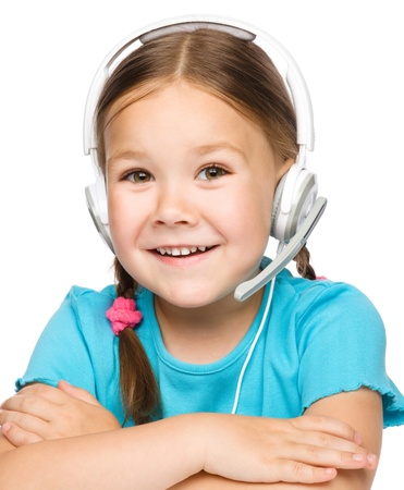 chat online: Cute young girl is working as an operator at helpline talking with customer using headset, isolated over white