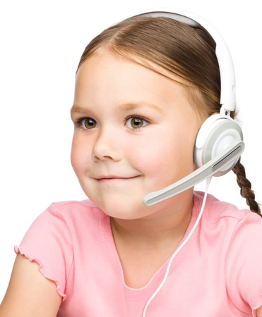 Closeup portrait of cute little girl talking to customers as a consultant using headset, isolated over white photo