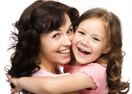 Portrait of happy daughter and her mother, isolated over white photo