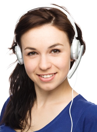 Closeup portrait of lovely young woman talking to customers as a consultant using headset, isolated over white Stock Photo - 15940452