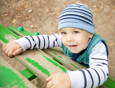 a serene life: Cute little boy is playing on playground