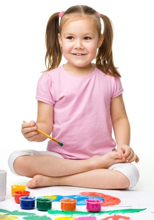 Cute cheerful child play with paints, isolated over white Stock Photo - 16120207
