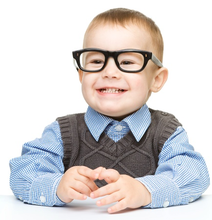 contented: Portrait of a cute little boy wearing glasses, isolated over white