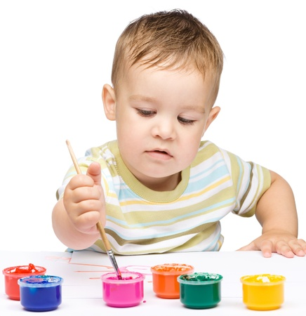 Portrait of a cute little boy playing with paints, isolated over white Stock Photo - 16120206